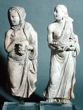 Two statuettes of standing monks, from Hadda