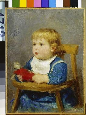 Girl in the child small chair