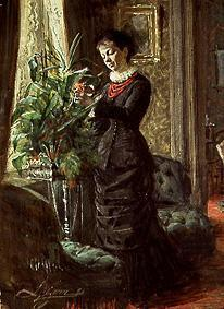 Mrs Lisen Samson when arranging flowers in front of a window