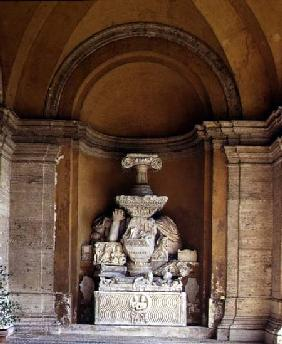 The inner courtyard detail of a niche displaying a collection of fragmentary antique sculpture