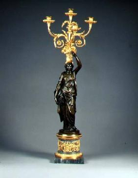 Louis XVI four-light candelabraormolu branches rising from a basket balanced on the head of a patina