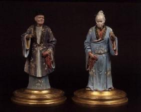 Pair of chinese terracotta figures, one male, one female,with nodding heads