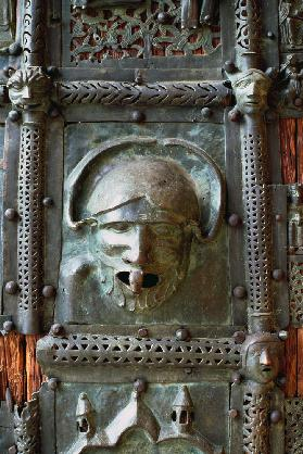 Gargoyle panel from the left door of the portal