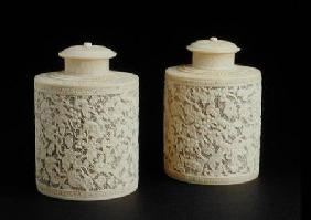Pair of carved ivory canisters and covers