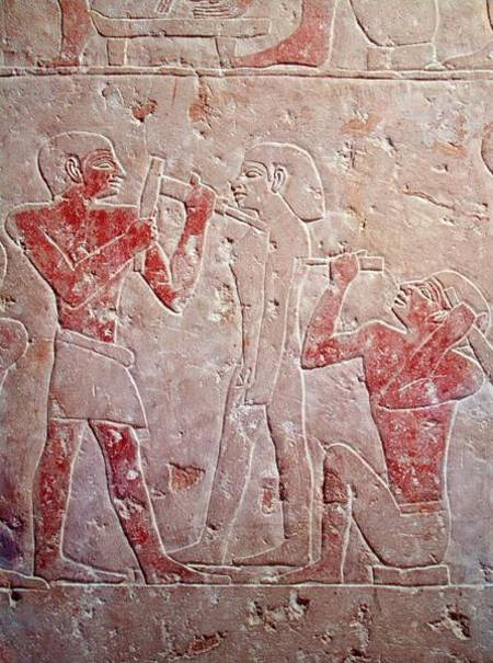 Relief depicting two sculptors carving a egyptian as art