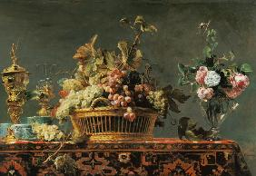Grapes in a basket and roses in a vase