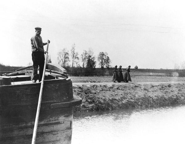 Barge being towed on a canal by three women, c.1900 (b/w photo)