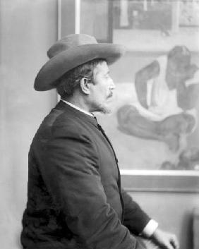 Paul Gauguin (1848-1903) in front of his canvases (b/w photo)