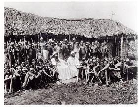 White Fathers before a chapel in adobe at Mugera (Urundi), before 1914 (b/w photo)