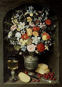 Bouquet of flowers being in a niche in a silver jug.