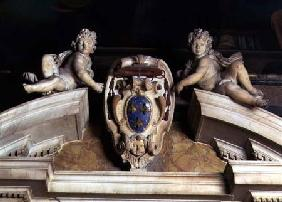 Interior view of the Barberini Chapel, detail of decorative pediment of two cherubs supporting a coa