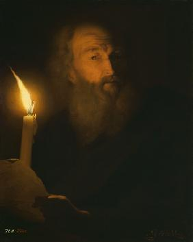 Portrait of a bearded man in the candlelight