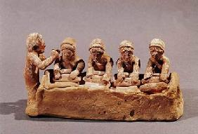 Bakers kneading dough to the sound of a flute, found at Thebes, Boeotia