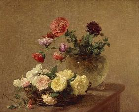 Flowers into glass vase and basket with roses