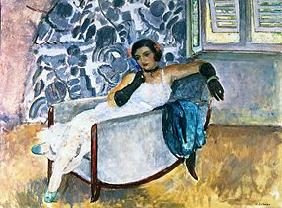 Lady with black gloves, sitting in an armchair.