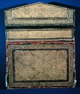 Outer face of a Koran case with gilded eslimi design of sura 56 in thulth