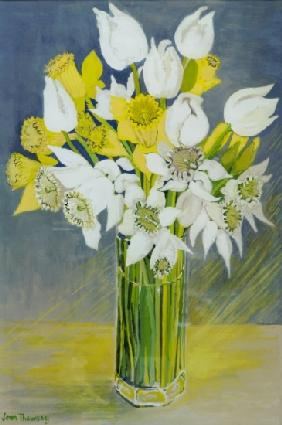 Daffodils and white tulips in an octagonal glass vase