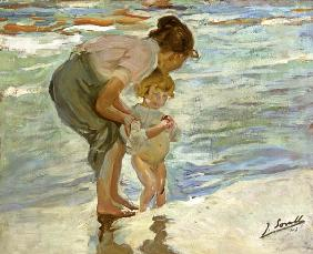 Mother and child on the beach.