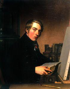 Self-portrait with Bible in front of the easel.