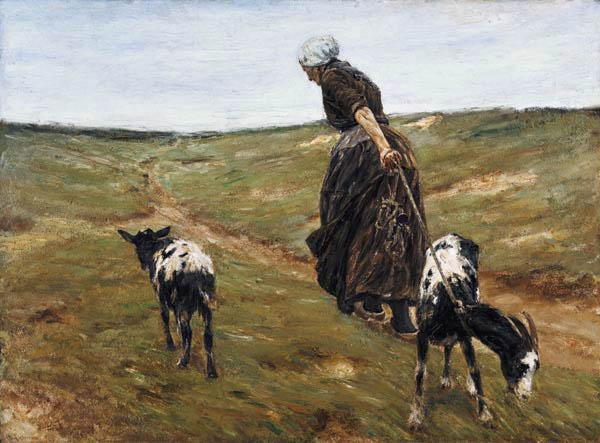 Woman with nanny-goats in the dunes