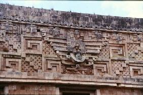 Carving detail from the Nunnery Quadrangle, Late Classic Maya