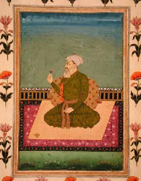 A ruler seated on a carpet or terrace, holding a flower, from the Small Clive Album