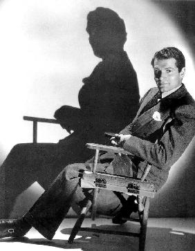 English Actor Laurence Olivier seated on a chair's director