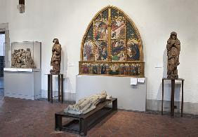 Interior of the gallery with an altarpiece and sculptures