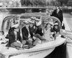 Josephine Baker and her children on a boat in Amsterdam
