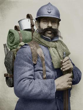 Portrait of a French soldier dressed with his sky blue military uniform and carrying a backpack, wit