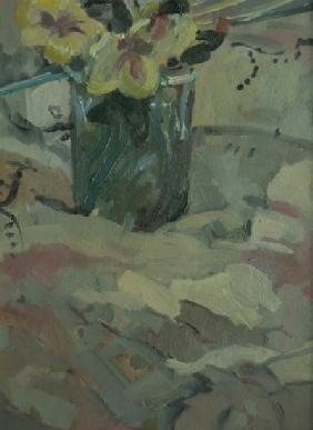 Yellow flowers in green pot