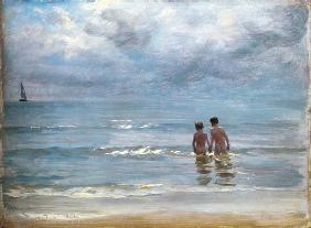 Boys in the sea at Skagen taking a bath