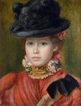Girl in black hat with red flowers