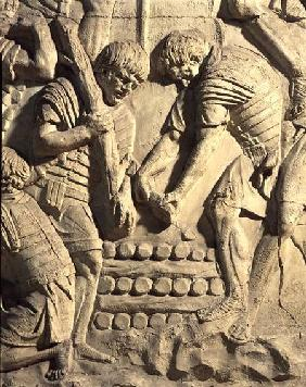 Construction of fortifications during the campaign against the Sarmatians, detail from a cast of Tra