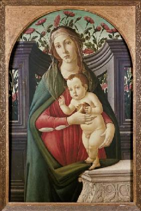 Madonna with child in a niche decorated with roses