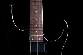 electric guitar silhouette isolated on b