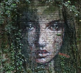 A fairy is looking through the ivy branches