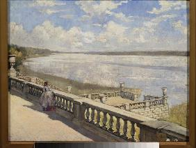Sunny day. A lady at the balustrade