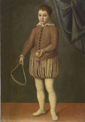 Portrait of a boy holding a tennis racket and ball